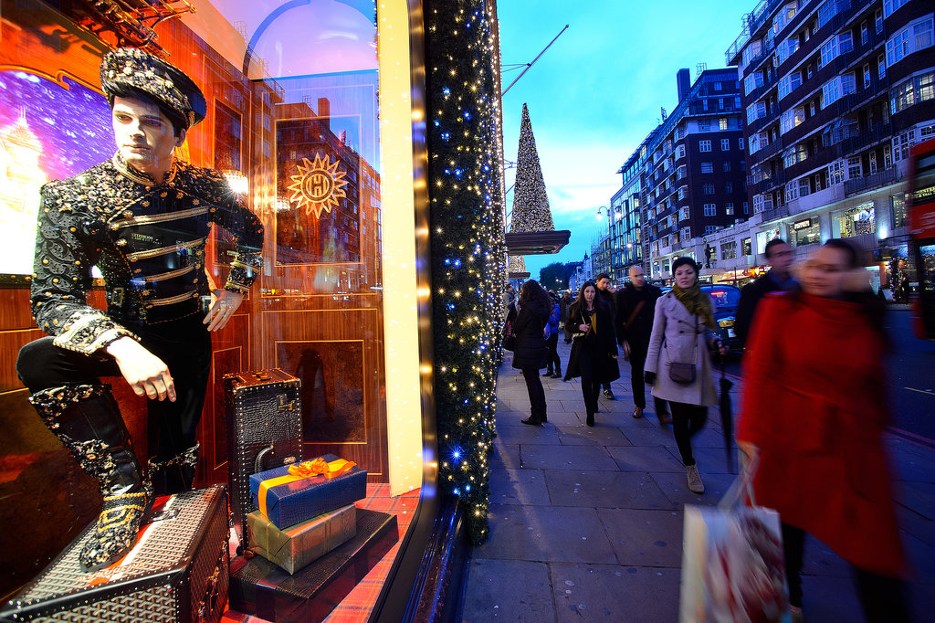 People checked out the Christmas window displays at Harrods in London.
