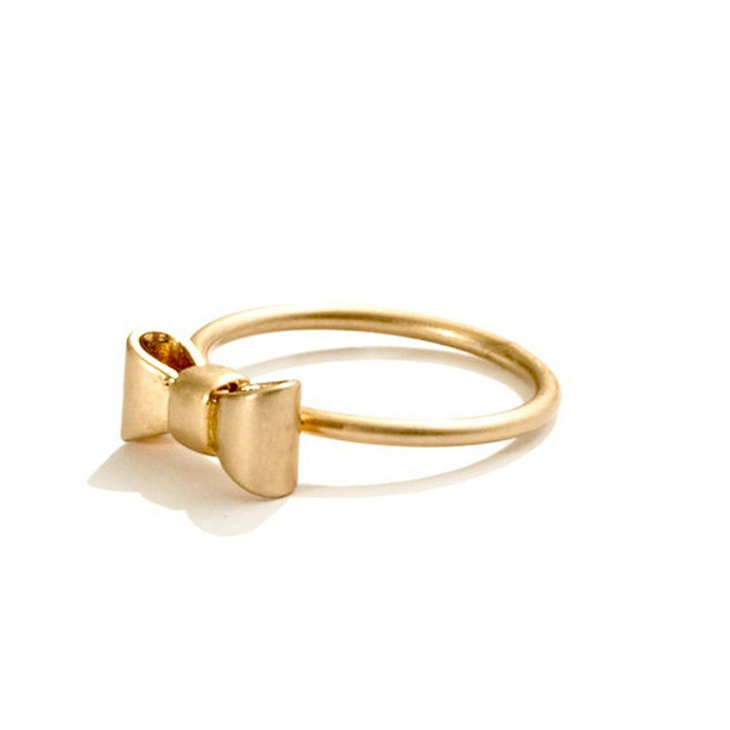 A preppy bow-tie ring ($15), like this one from Madewell, will add a feminine flair to any look.