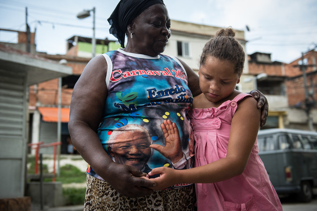 A woman in Brazil hugged her daughter while wearing a Nelson Mandela shirt.