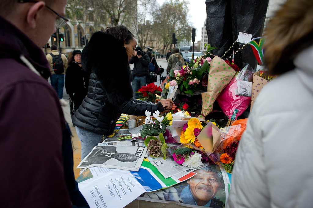 People gathered at a memorial in London.