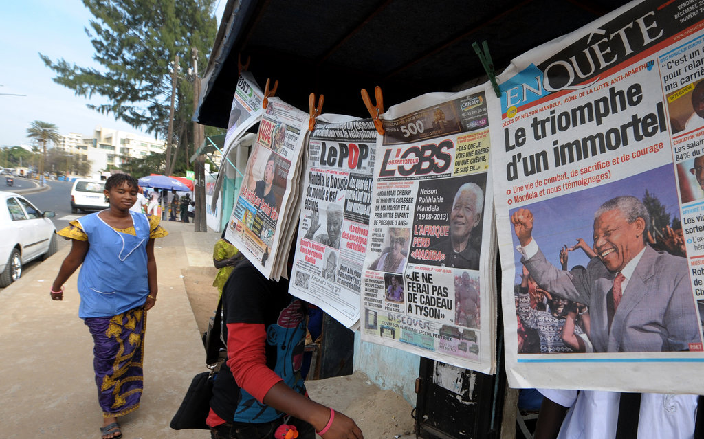Newspapers covering Mandela's death were hung in Senegal.