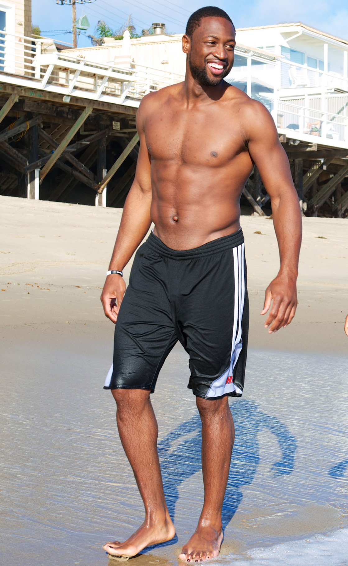 In September, Dwyane Wade was all smiles shirtless on the beach in Malibu.