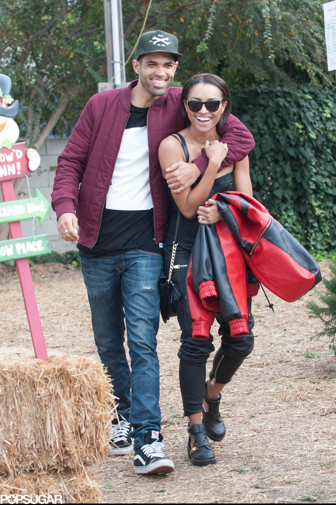 Vampire Diaries star Kat Graham and fiancé Cottrell Guidry showed off adorable PDA while Christmas tree shopping in LA.