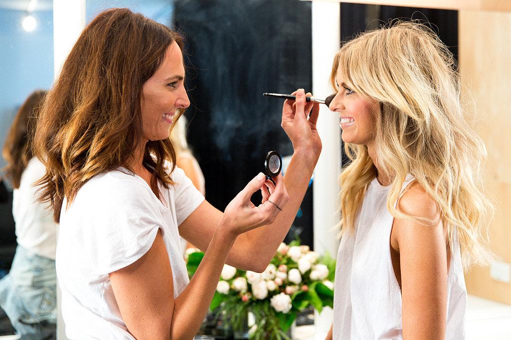 Tash and Elle play makeup on set.