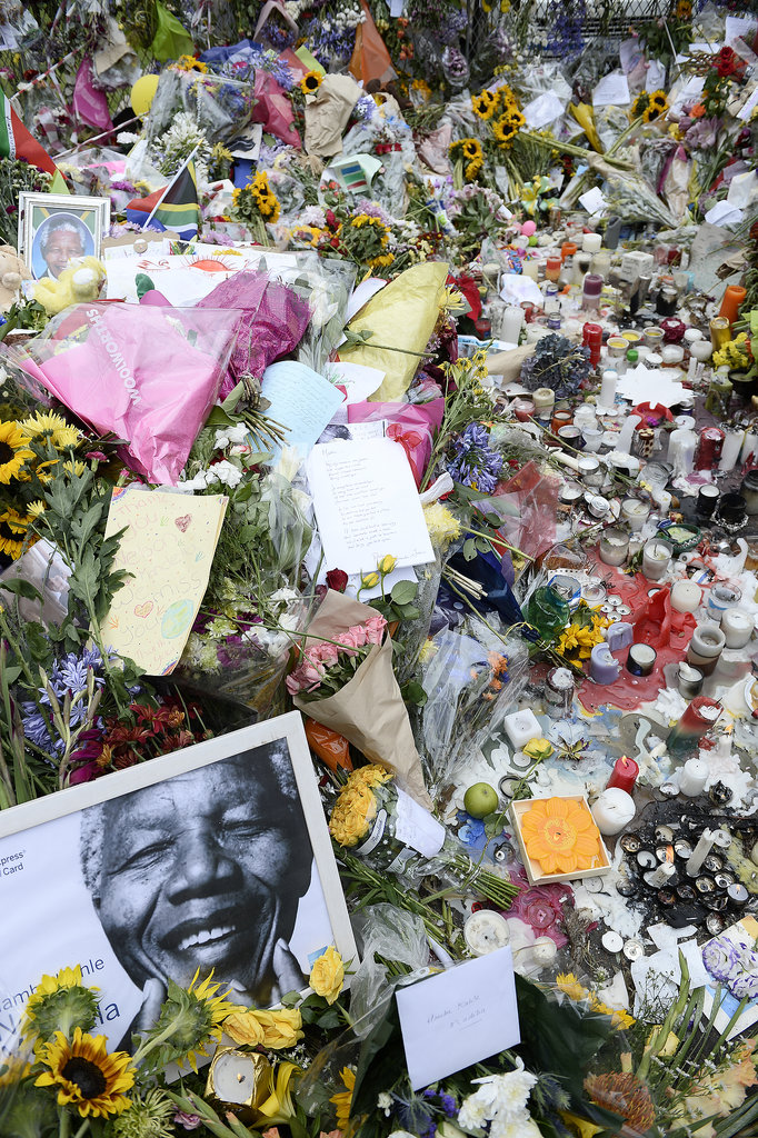 In Johannesburg, flowers piled up for the late leader.