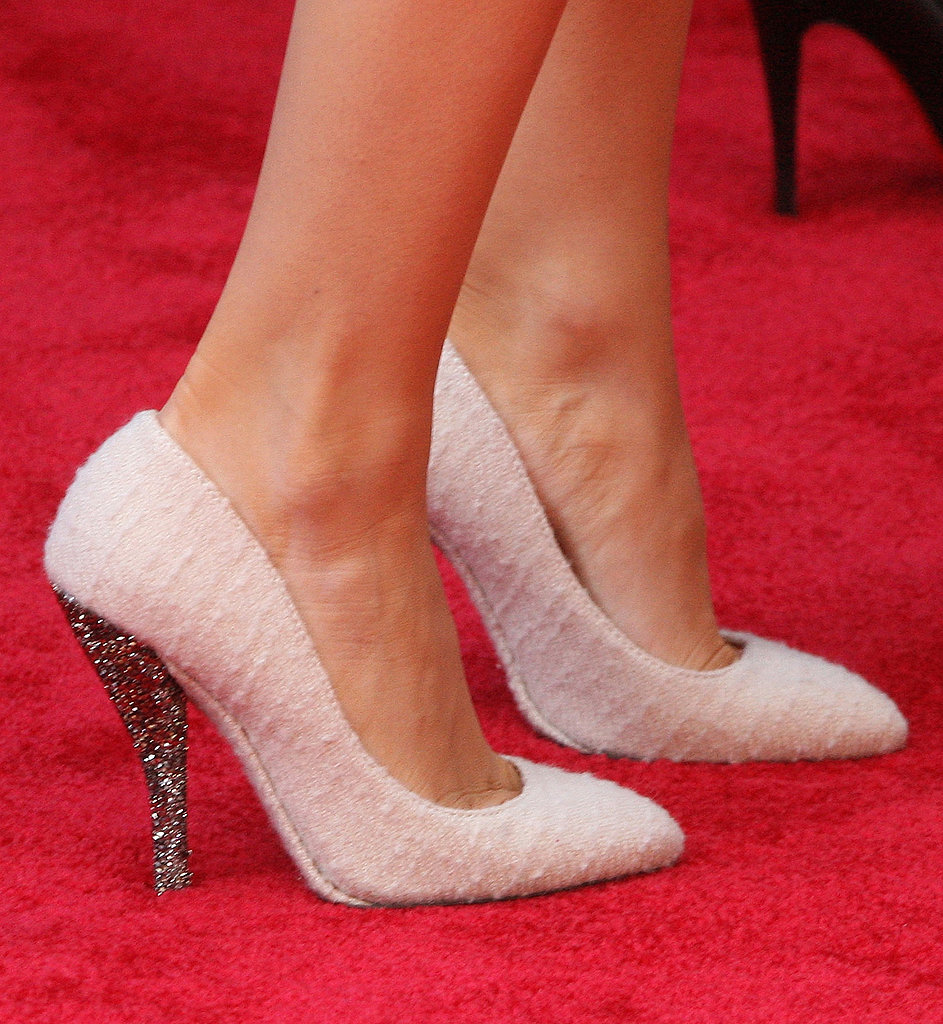 Blake Lively attended an early Spring premiere of The Croods in textured white pumps.