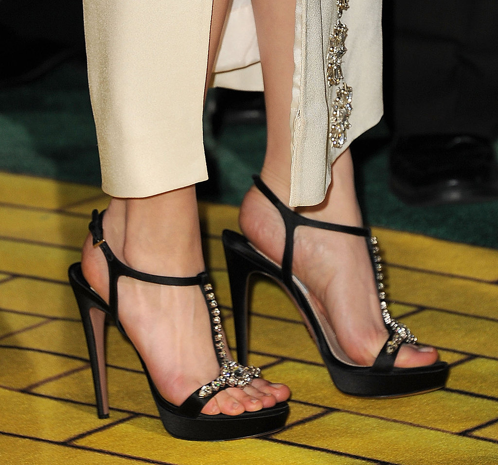Michelle Williams walked down the yellow brick road, literally, at the LA premiere of Oz the Great and Powerful in bejeweled T-bar sandals.