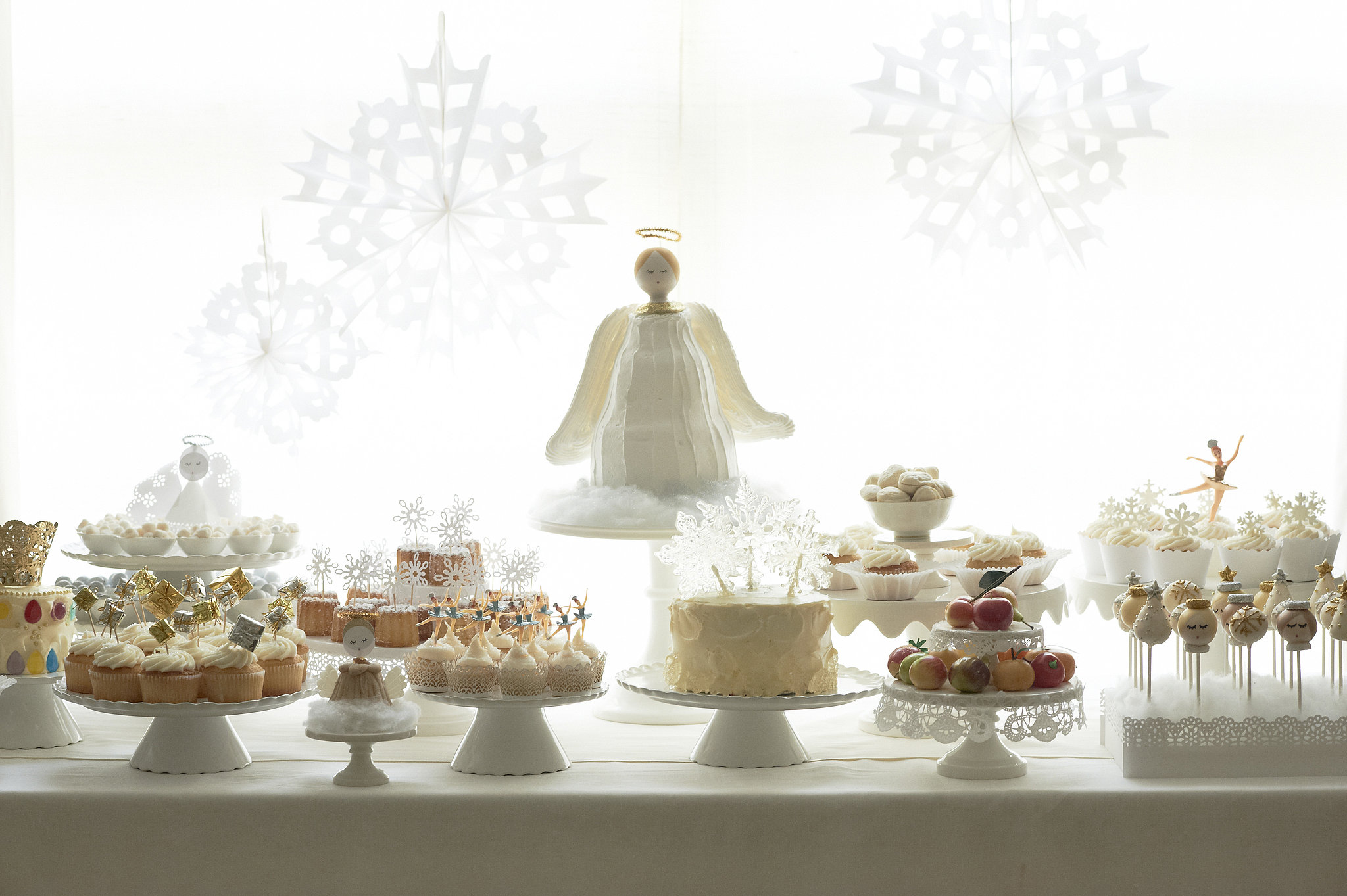 An Angel Dessert Table Filled With Nutcracker Sweets A ...