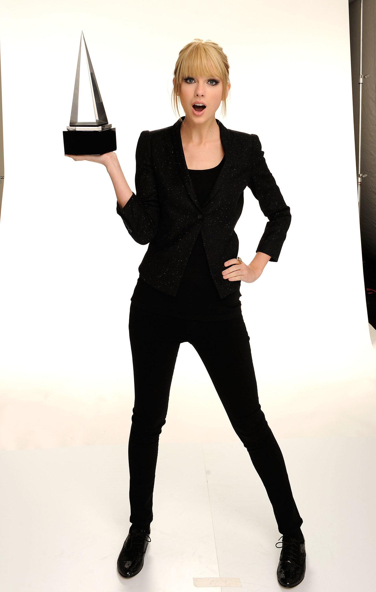 Taylor posed for portraits at the American Music Awards in November 2010.