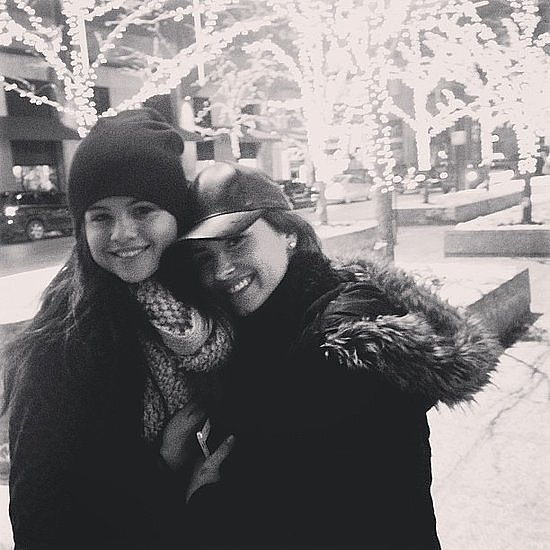 Selena Gomez and best friend Demi Lovato stayed warm with a hug in front of festively-lit trees. Source: Instagram user selenagomez