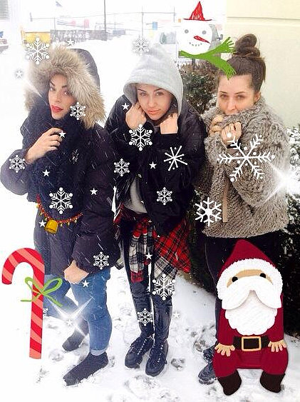 Miley Cyrus shared a snowy snap with her girlfriends on Twitter in December 2013. Source: Twitter user Mileycyrus