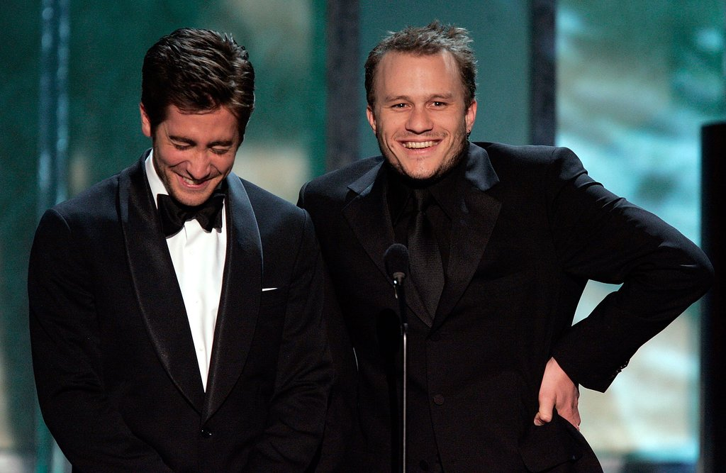 Jake couldn't help but laugh while presenting on stage with Heath Ledger at the SAG Awards in January 2006.