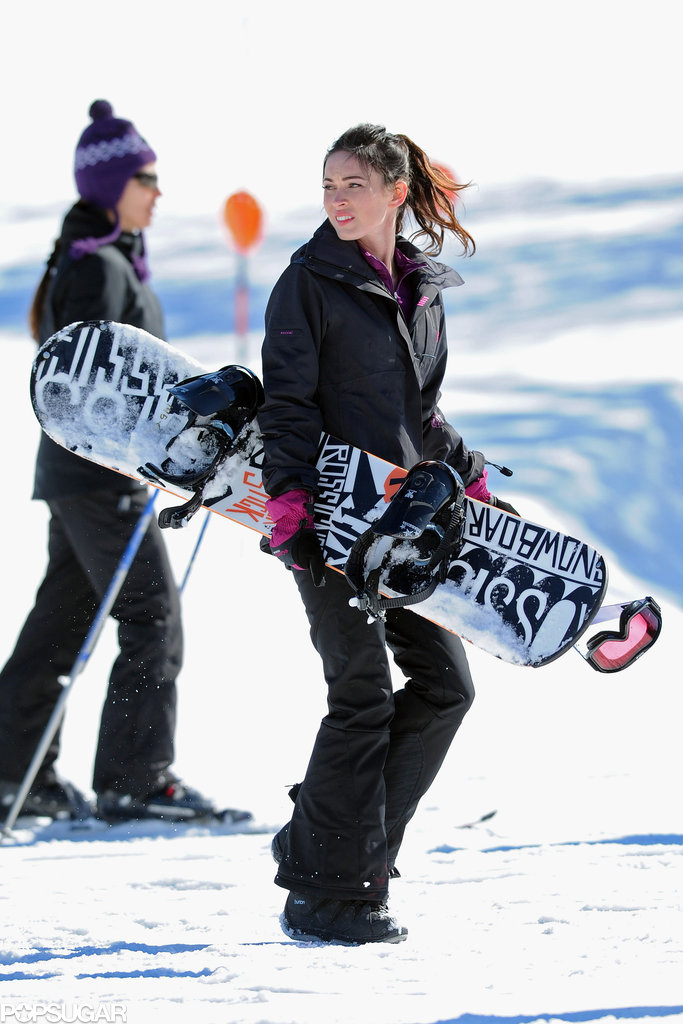 Megan Fox carried a snowboard on the Orange County, NY, set of Friends With Kids in February 2011.