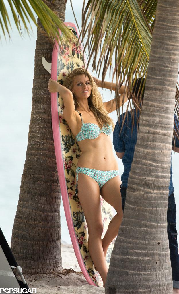 She lounged against a surf board in her bikini.