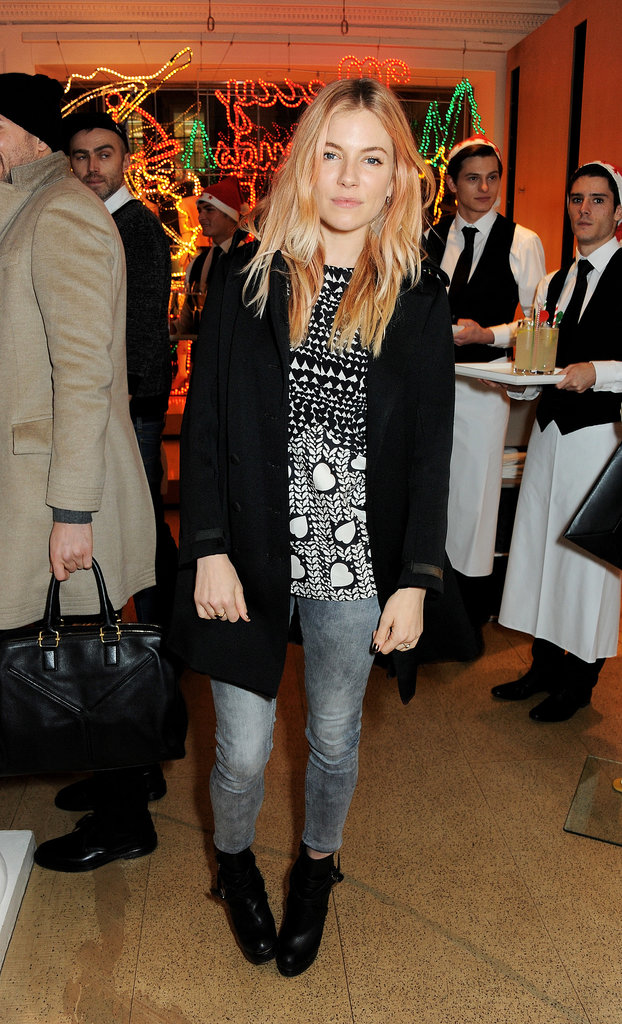 Sienna's breezy model pose mimicked the no-fuss vibe of her black and gray ensemble in December 2013.