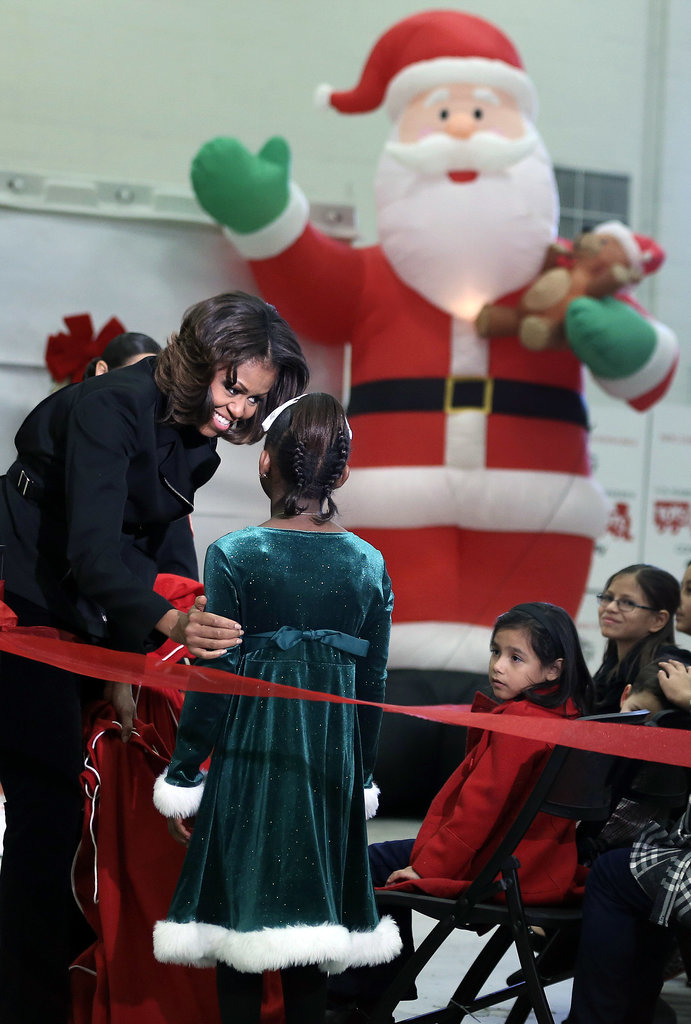 First Lady Michelle Obama was all smiles at the toy drive.