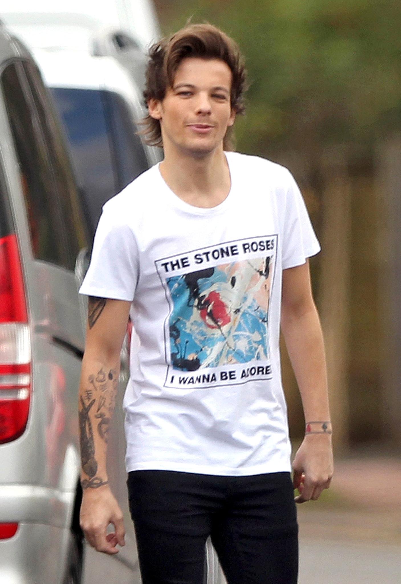 "Louis's shirt read ""I wanna be adored."""
