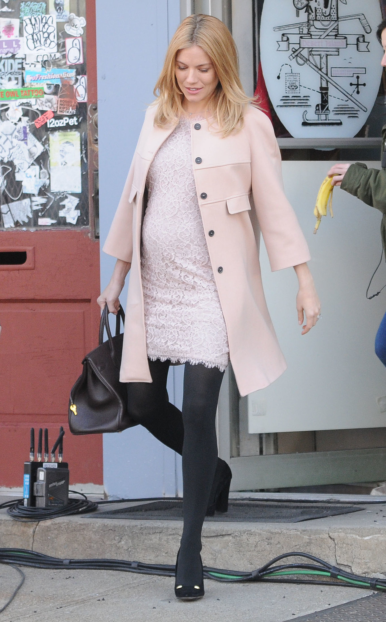 She was pretty and pregnant in pink on the set of A Case of You in February 2012.