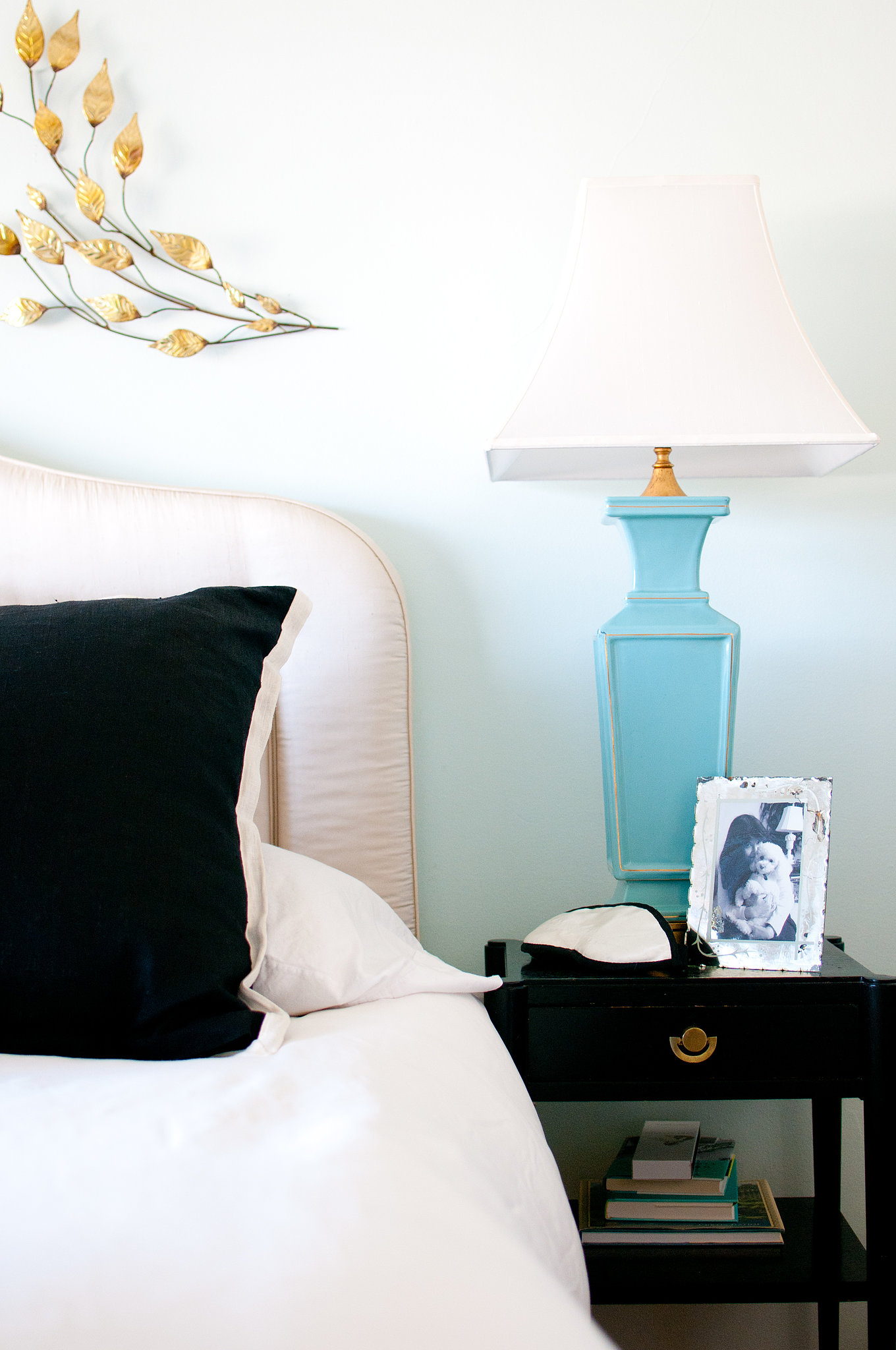 Bold turquoise bedside lamps echo the softer hues of the pillows. Source: Kassie Borreson