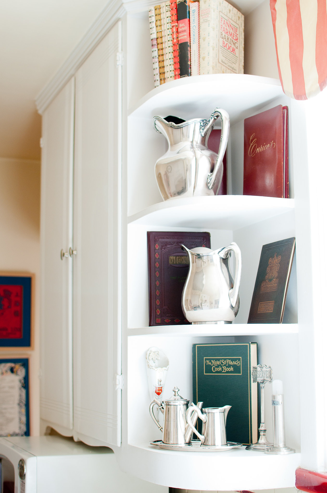 Lynn decorates her kitchen built-ins with old hotel silver, menus, and cookbooks.  Source: Kassie Borreson