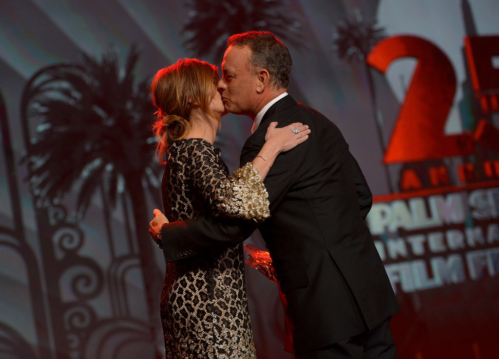 Tom Hanks planted a kiss on Julia Roberts.