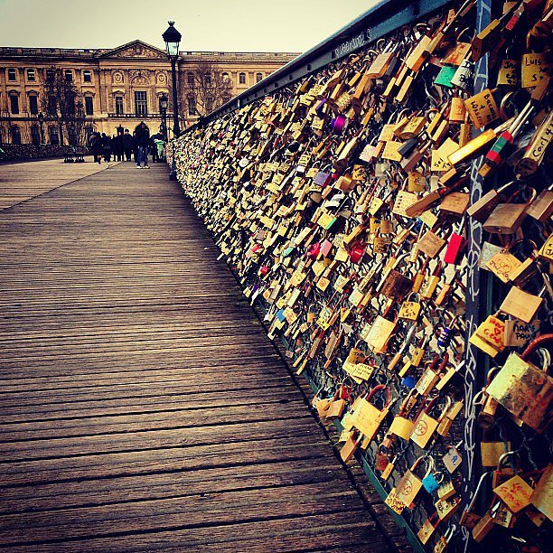 add a lock to the love lock bridge in paris 83 travel