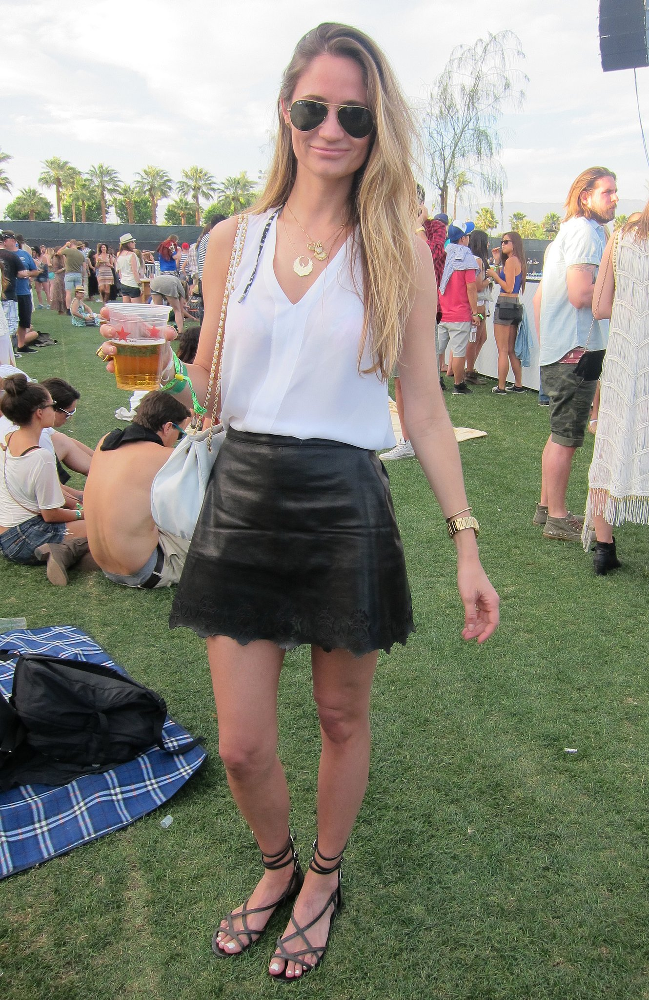 This cool take on black and white comprised a scalloped leather skirt and a silky tank. Source: Chi Diem Chau
