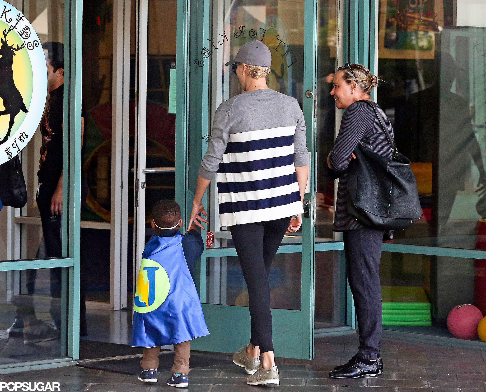 Charlize held Jackson's hand as they entered the gym.