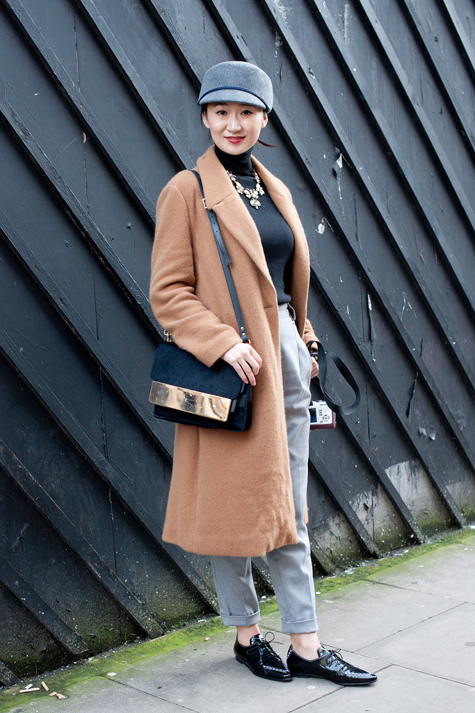 She took a page out of the guys' playbook with a well-cut coat and a pair of brogues.