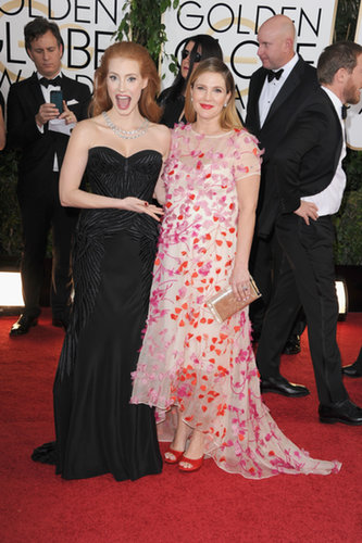 Jessica Chastain showed off Drew Barrymore's baby bump on the Golden Globes red carpet.