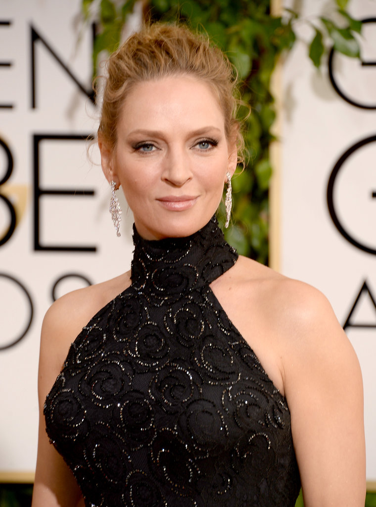 Uma Thurman's wispy updo allowed for her beaded Versace gown to take center stage.