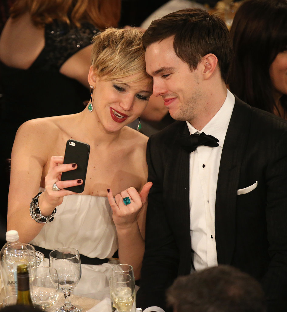 Jennifer Lawrence and Nicholas Hoult took a selfie at their Golden Globes table.  Source: Christopher Polk/NBC/NBCU Photo Bank/NBC