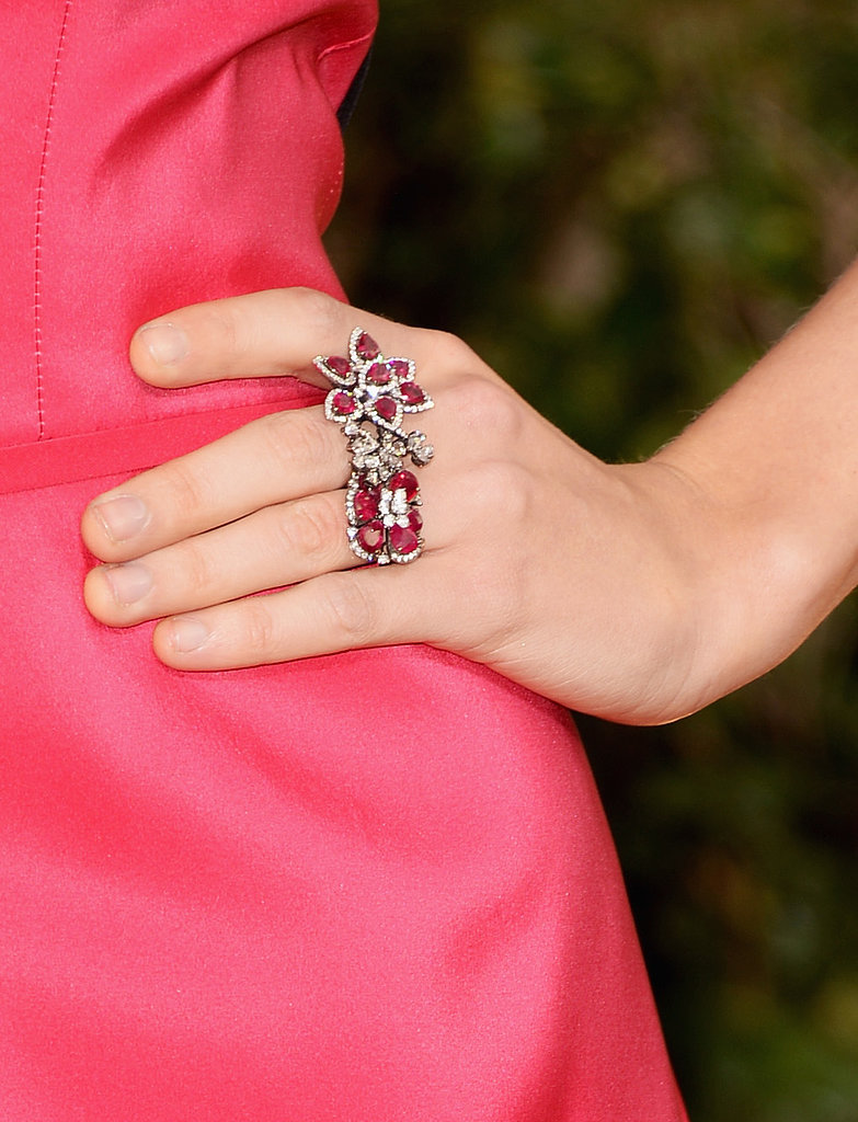 Ever the girlie girl, Taylor Swift accessorized her pink Carolina Herrera gown with a Lorraine Schwartz ruby and diamond flower cluster three-ring.