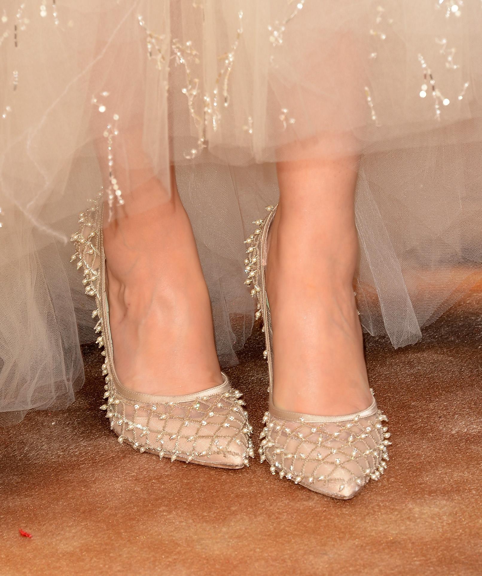 Zooey Deschanel showed off pearl-embellished heels fit for a princess.