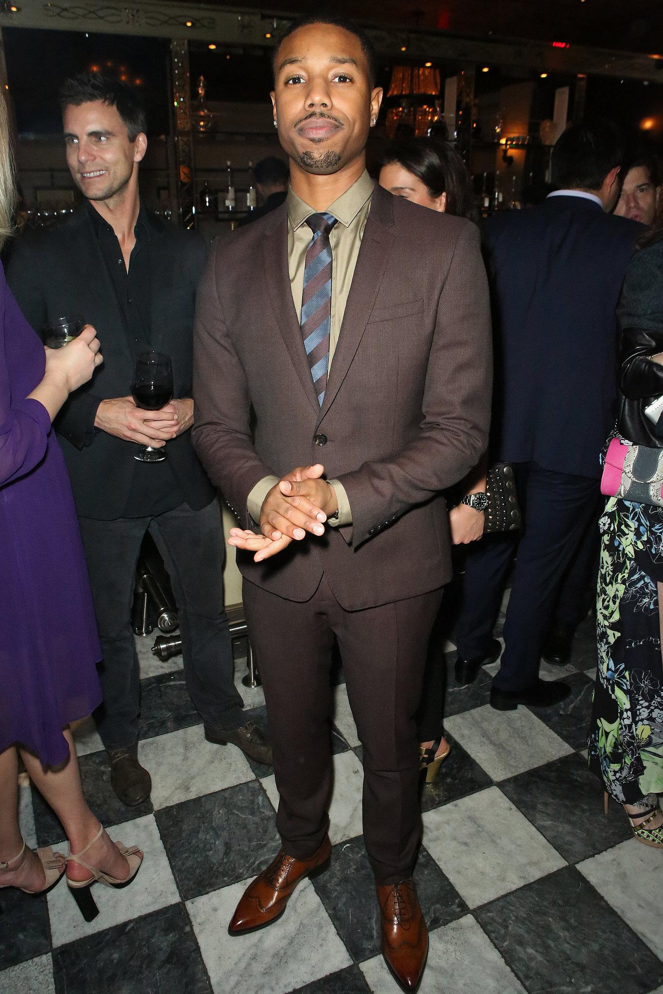 Michael B. Jordan wore a brown suit.
