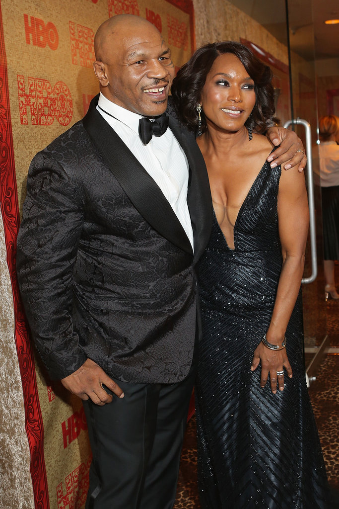 Mike Tyson posed on the carpet with Angela Bassett.
