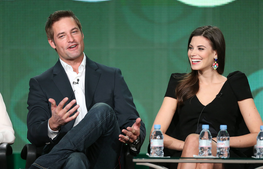 Intelligence stars Josh Holloway and Meghan Ory laughed.