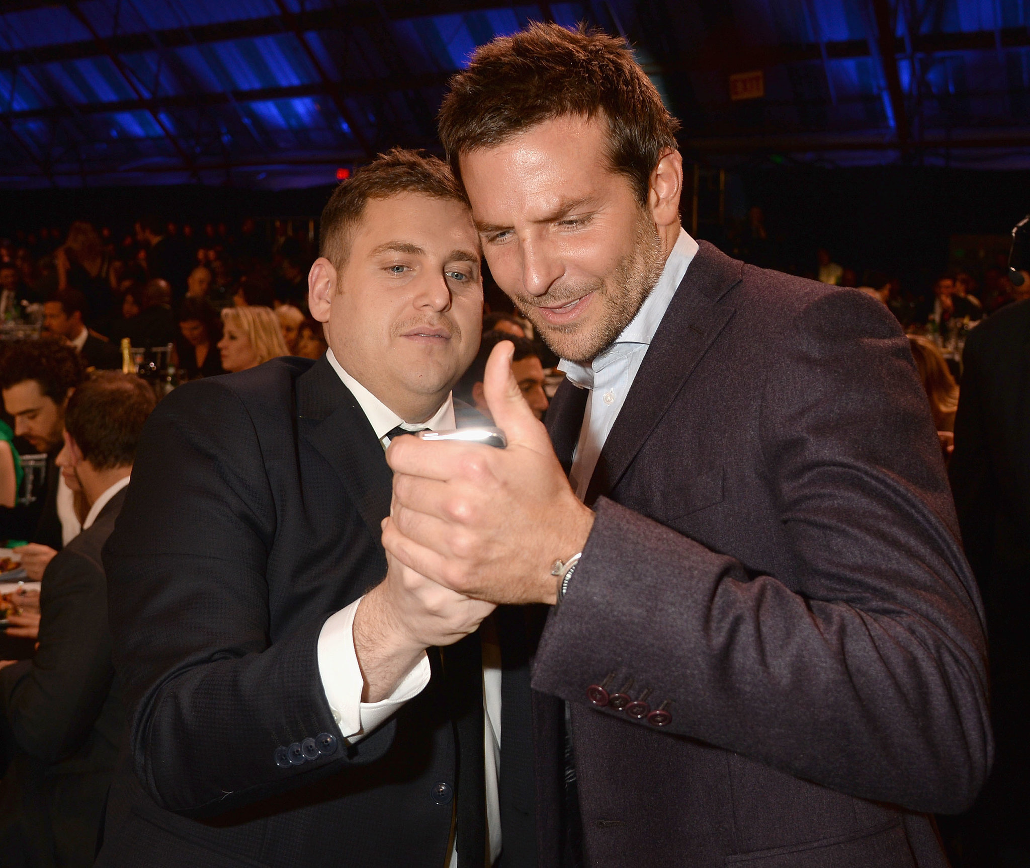 Jonah Hill and had some boisterous fun while looking pics on a phone