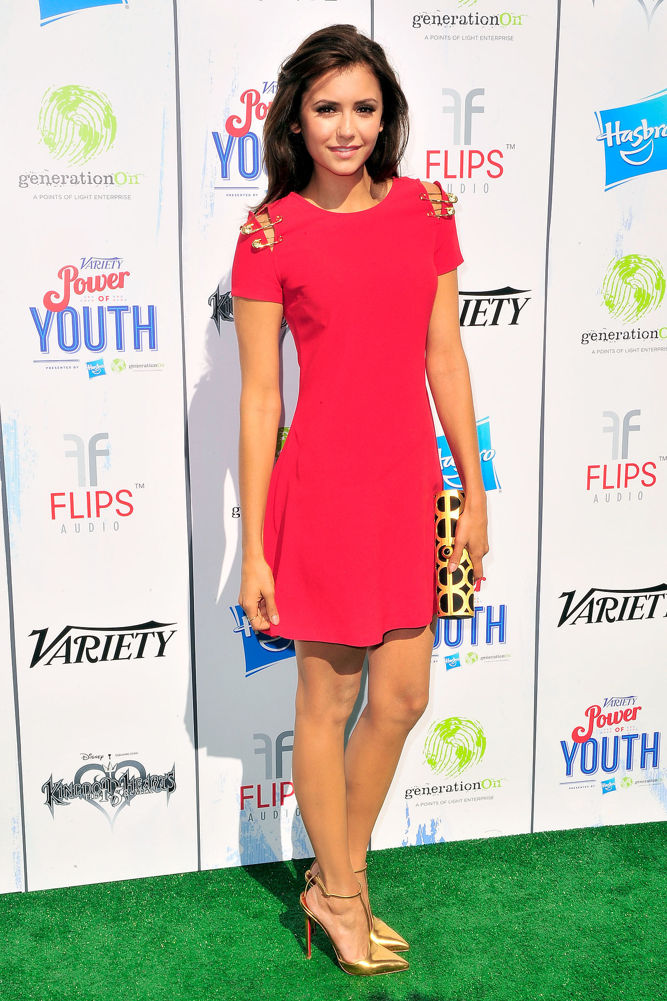 The Vampire Diaries star Nina Dobrev wowed in a Fall 2013 Versus Versace mini with gold T-strap pumps. We lov