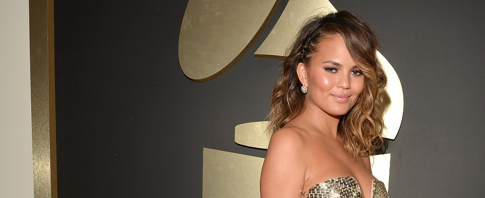 Is Chrissy Teigen's Glow Competing With the Actual Grammy Award?