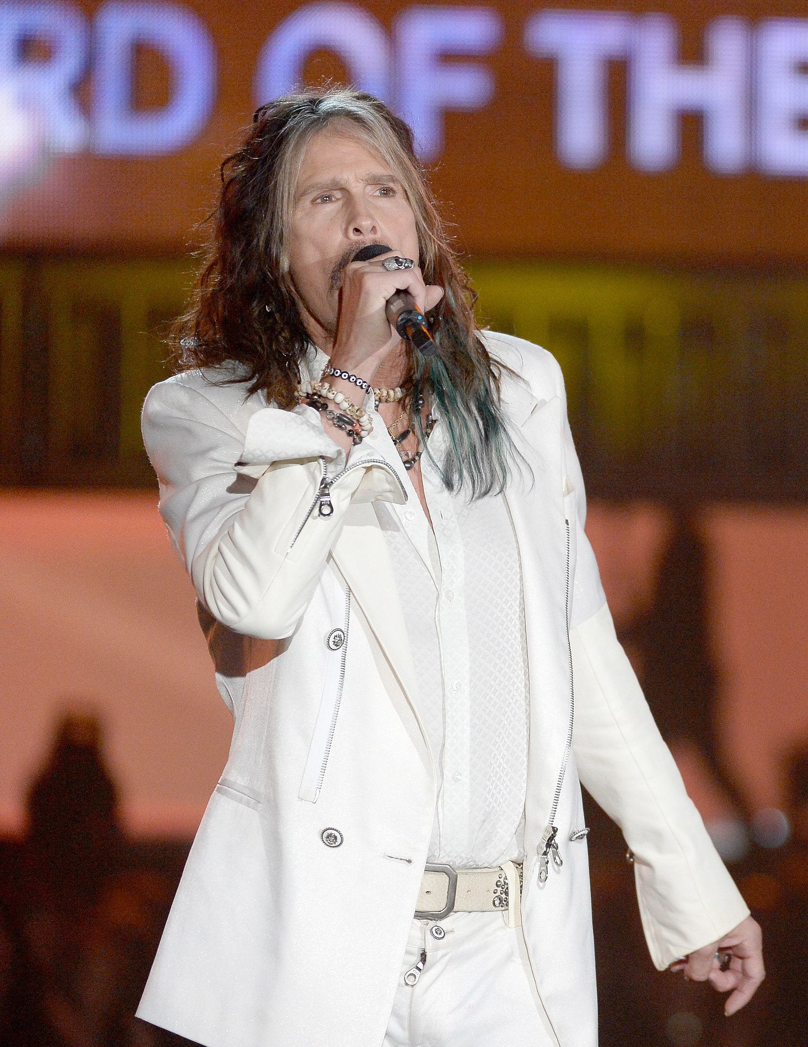 Steven Tyler sang while introducing a performance.