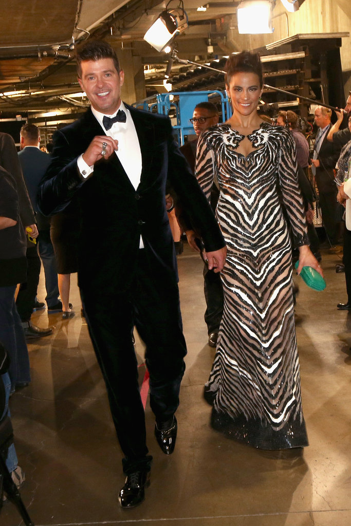 Robin Thicke and Paula Patton held hands backstage.