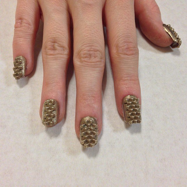 """Kingdom"" nails printed in brass.  Source: Instagram user thelasergirls"