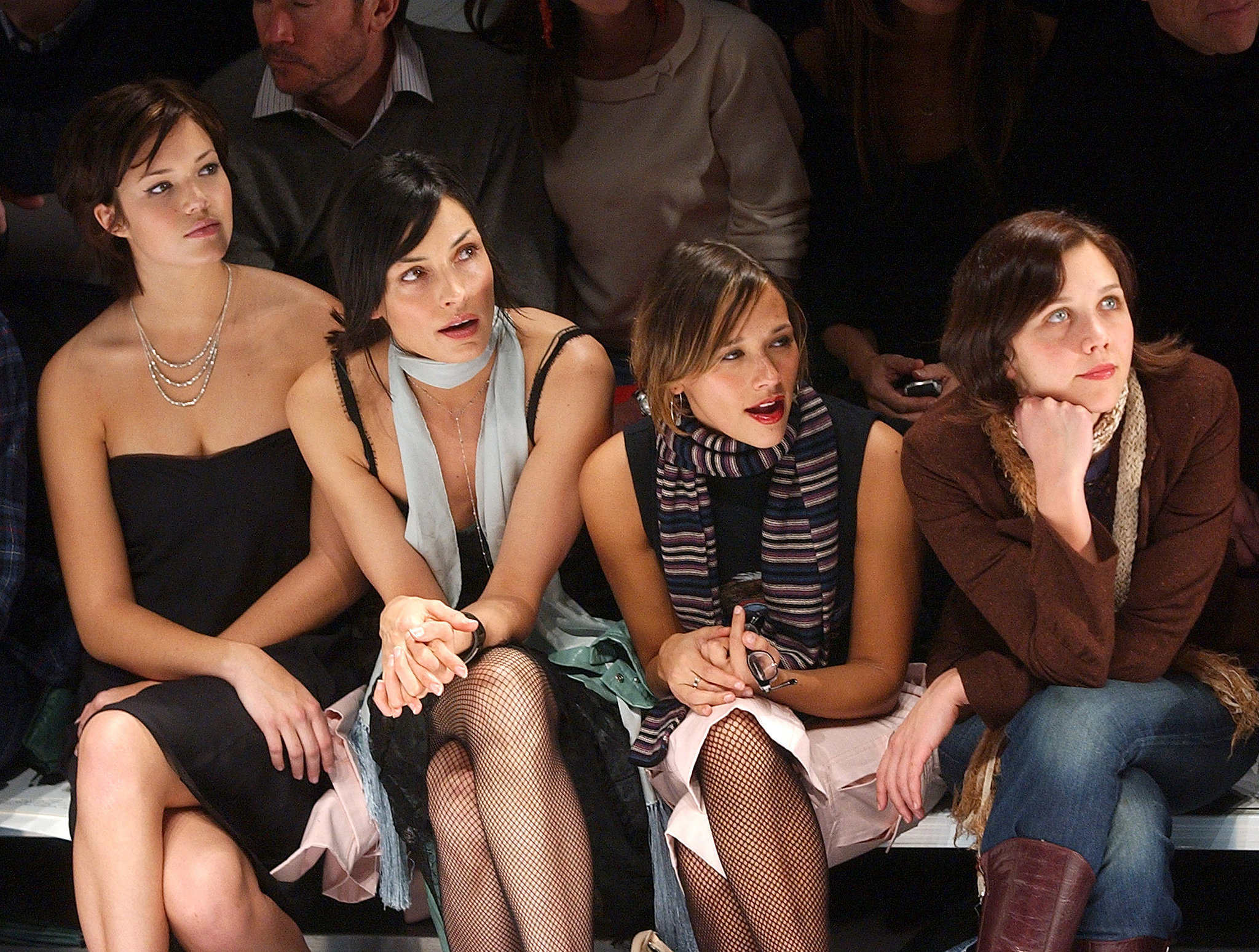 Mandy Moore, Famke Janssen, Rashida Jones, and Maggie Gyllenhaal focused at Marc Jacobs in September 2003.
