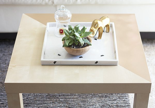 This coffee table is the perfect example of how versatile Ikea furniture is. With spray paint and painter's tape, a blank canvas can be turned into a pretty, gold-painted coffee table.  Source: Kristi Murphy