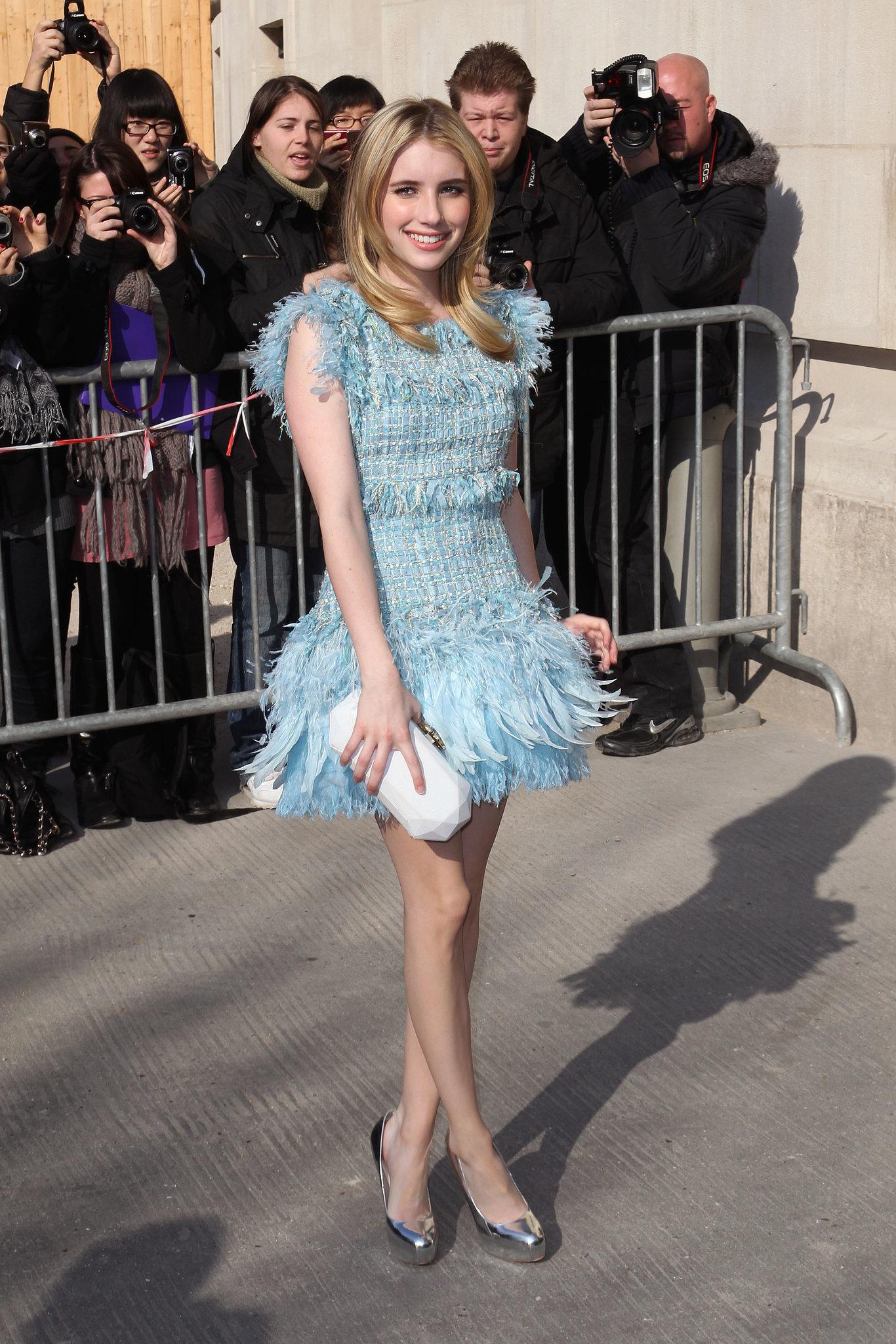 Emma got flirty in a fringed Chanel dress for Paris Fashion Week in 2011.