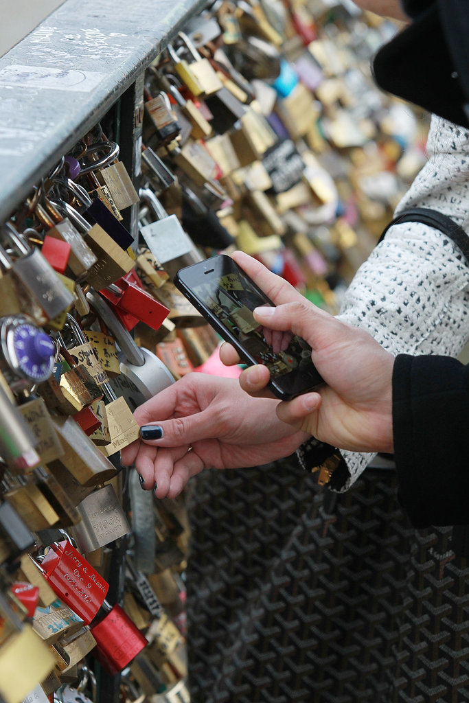 People took photos of padlocks on the Pont des Arts in Paris.