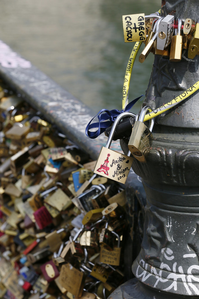 Love padlocks covered the Pont des Arts bridge in Paris.