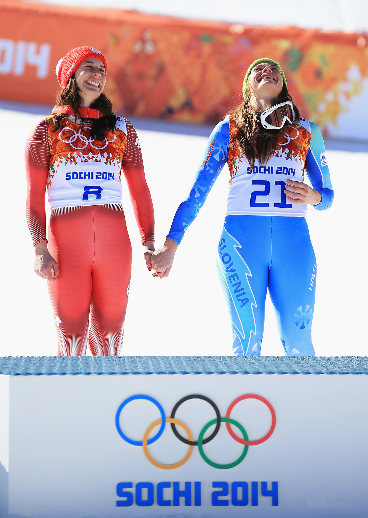The women held hands at the podium, all smiles.