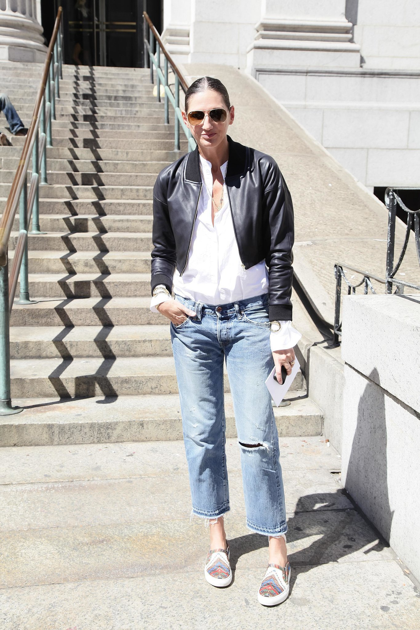 Casual Jenna mixed basics you likely have at home — relaxed boyfriend jeans, a leather jacket, and comfy kicks.